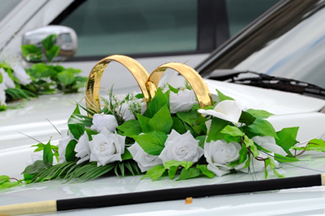 Beautiful floral decoration is on a wedding car